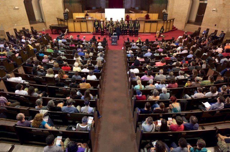 aerial photo of a church gathering in pews